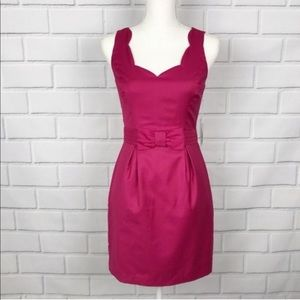 Pink contemporary scalloped bow-front dress